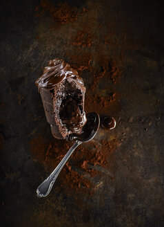 Chocolate muffin with liquid core, cocoa and tea spoon - KSWF001741