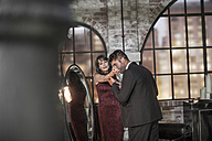 Well-dressed couple in an apartment - ZEF008454
