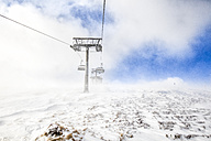 Austria, Turracher Hoehe, chair lift in clouds - DAWF000508