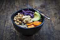 Bowl of quinoa, avocado, roasted chick-peas, sweet potato, red cabbage and hummus - LVF004535