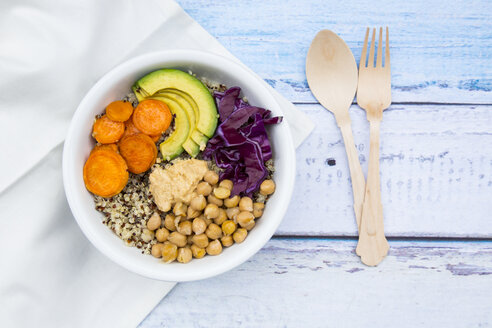 Bowl of quinoa, avocado, roasted chick-peas, sweet potato, red cabbage and hummus - LVF004538