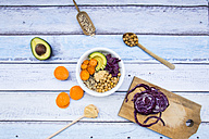 Bowl of quinoa, avocado, roasted chick-peas, sweet potato, red cabbage and hummus - LVF004541