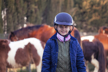 Portrait of smiling girl on horse farm - XCF000061