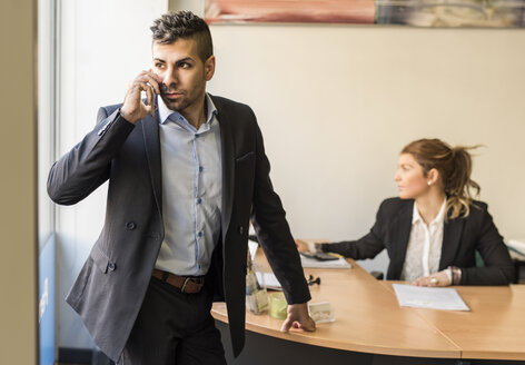 Businessman on the phone in office - JASF000451