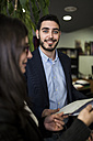 Portrait of smiling young man in office - JASF000454