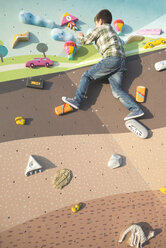 Boy at climbing wall on a playground - DEG000641