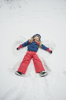 Little girl making a snow angel - IPF000285