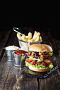 Large hamburger with fries, mayonnaise and ketchup - CSF027189