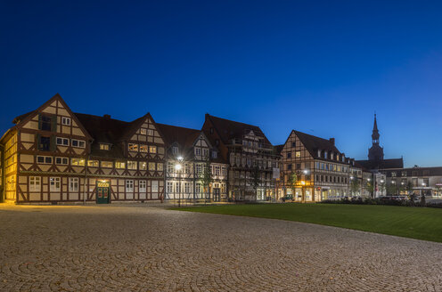 Germany, Wolfenbuettel, Half-timbered houses and Trinity Church in the evening - PVCF000768