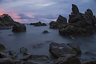 Spain, Costa Brava, Lloret de Mar, rock formations at Cala dels Frares by sunset - SKCF000058
