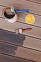 Applying glaze with brush on floorboards - GWF004633