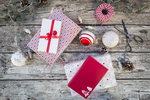 Christmas decoration and wrapped presents on wood - LVF004546