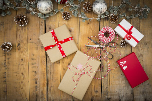 Christmas decoration and wrapped presents on wood - LVF004549
