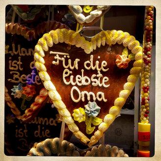 Germany, Gingerbread heart at Hamburg Dom fair - EGBF000133