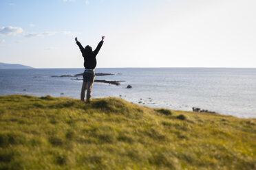 Ireland, Man enjoying the wind in Connemara - GIOF000769