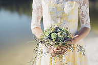 Woman holding bridal bouquet, close-up - MJF001712
