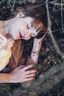 Portrait of happy woman with close eyes relaxing in nature - MJF001733