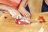 Cutting steak on chopping board - FMKF002323