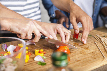 Cutting vegetables on chopping board - FMKF002329