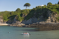 UK, Wales, Boat at cliffs of Cwm-yr-Eglwys bay - SH001883