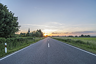 Germany,  Lower Saxony, Peine, Country road at sunset - PVCF000783