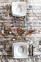 Two place settings on autumnal decorated table - SARF002572