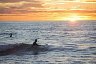 Two surfers at sunrise - SKCF000064