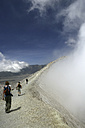 Indonesia, Java, Travellers hiking on crater rim of Mount Bromo - DSG000987