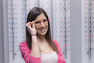 Portrait of smiling woman in an optician shop - ERLF000138