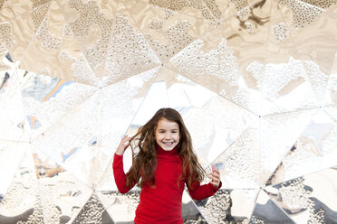 Portrait of smiling little girl in front of metal wall - VABF000219