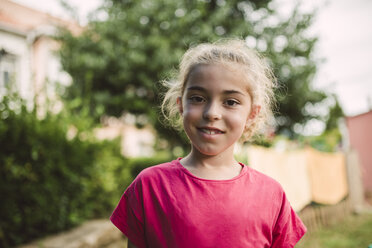 Portrait of smiling blond girl - RAEF000906