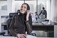 Middle Eastern businesswoman in office talking on the phone - ZEF008579