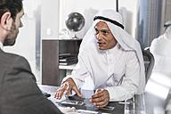 Businessman having meeting in Middle Eastern office - ZEF008585