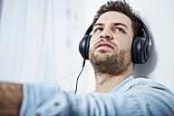 Young man wearing headphones - SEGF000458