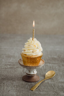 Festive decorated cup cake with lighted candle - ECF001852