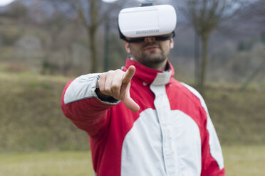 Man playing with Virtual Reality Glasses in nature - SKCF000073
