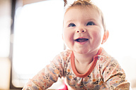 Portrait of smiling baby girl looking up - BRF001260