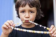 Portrait of little boy with necklace of Hundreds and Thousands - VABF000244