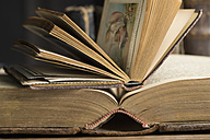 Two opened book in a historic library, close-up - CRF002739