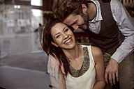 Happy young couple in a cafe - SUF000065