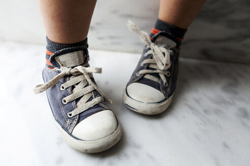 Close-up of boy wearing sneakers - VABF000273