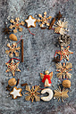 Christmas decoration, cookies, spices and nuts building a frame - MYF001363