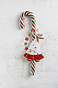Candy cane with angel figurine on white wood - MYF001365
