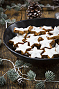Cinnamon stars in bowl and christmas decoration - LVF004592