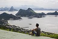 Brazil, Rio de Janeiro, tourist sitting at view point - MAUF000250