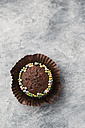 Cupcake with chocolate icing and sugar beads, copy space - MYF001367