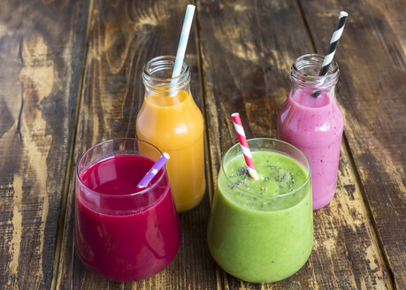 Glasses of four different smoothies  on wood - SARF002609