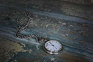 Old pocket watch showing five to twelve - CRF002742