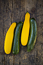 Two yellow and two green zucchini on dark wood - LVF004605
