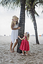 Brasil, Rio de Janeiro, mother and daughter playing on Copacabana beach - MAUF000257